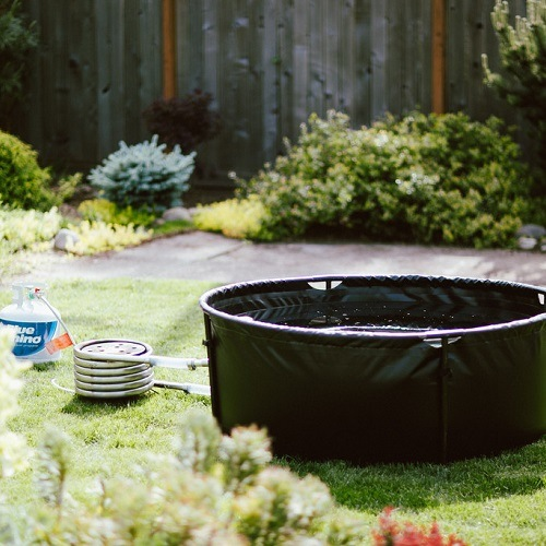basic portable hot tub in a backyard