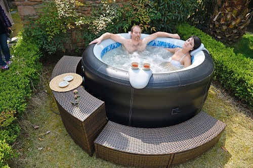 Couple Relaxing in an Inflatable Hot Tub