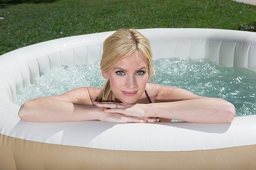 Woman in SaluSpa Palm Springs AirJet Inflatable 6-Person Hot Tub