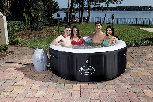 Bestway SaluSpa Miami AirJet Inflatable Hot Tub With People Outside